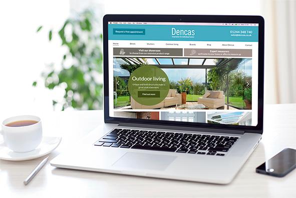 Dencas-website-on-laptop-featured